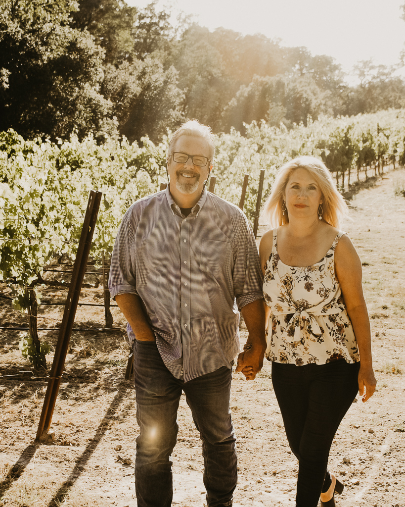 Kent and his wife Hollie walking in vineyard