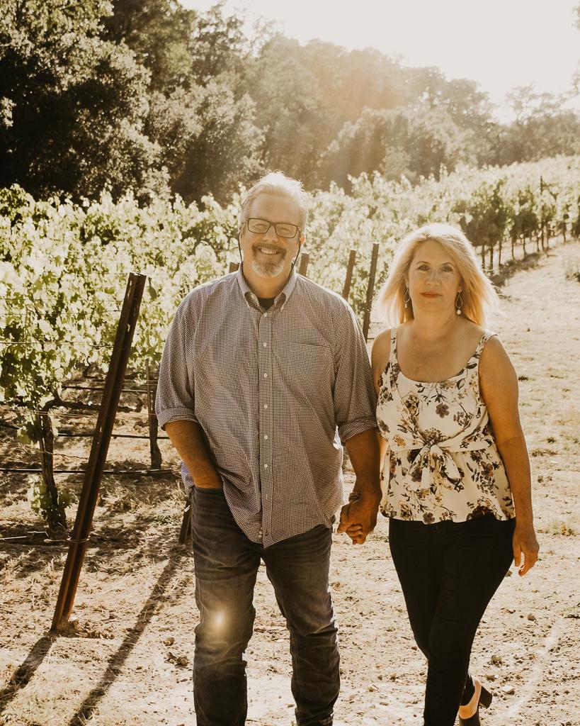 Kent and his wife Hollie walking in vineyard